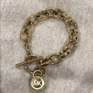 Michael Kors Gold Bracelet with logo charm